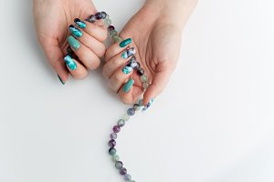 Closeup of woman hands with colorful nails