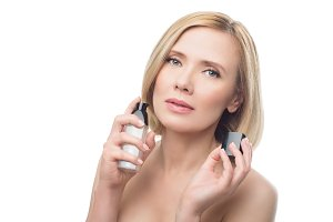 Beautiful middle aged woman with face serum