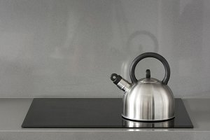 Steel teapot on induction stove