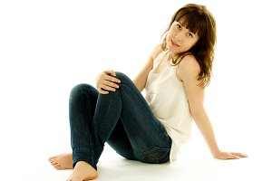 Young Woman in Jeans and Barefoot