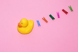 rubber yellow duck and clothespins