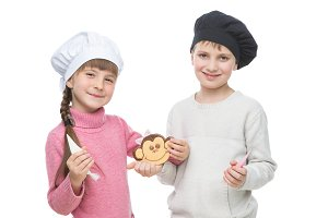 Children with gingerbread christmas cookie