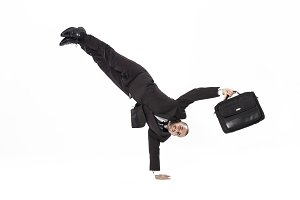 Breakdancer businessman with briefcase