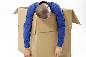 Man inside a cardboard box