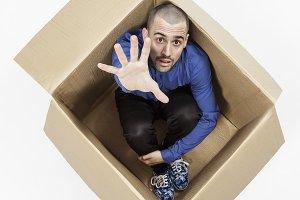 Man inside a cardboard box for help