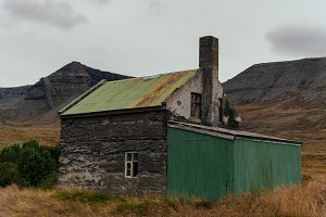Abandoned Farm in front of Mountains