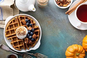 Pumpkin waffles with whipped cream for breakfast