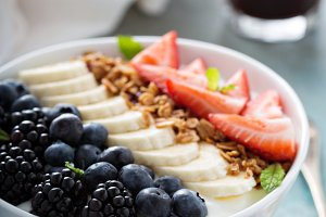 Yogurt bowl with banana and berries