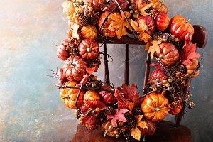 Festive autumn wreath with pumpkin and fall leaves