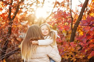 Cute family hug. Autumn. Sunset.
