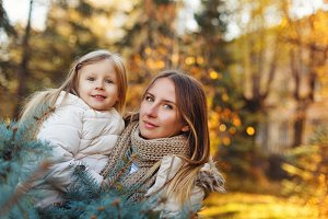 Mother hugs daughter. Fall.