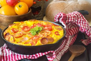 Omelette with tomatoes and sausages for beautiful tasty autumn breakfast
