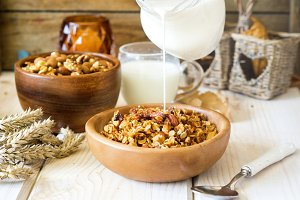 Healthy granola with nuts and milk for breakfast
