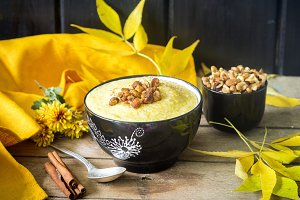 Healthy cornmeal porridge polenta with nuts for beautiful autumn breakfast