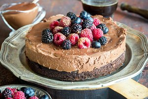 Beautiful tasty chocolate truffle mousse cake with fresh berries, selective focus