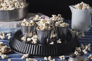 Dark still life with popcorn for a party