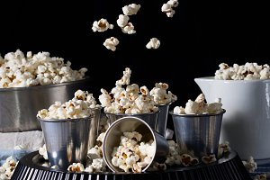 Popcorn in motion on black background