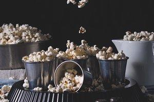 Dark still life with popcorn in motion