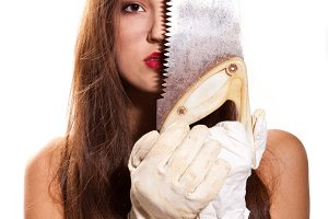 woman in glove with saw