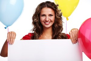 woman with three color balloons