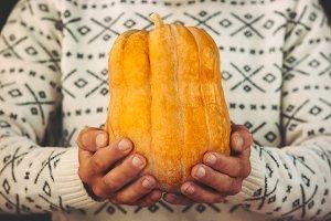 Man Hands holding orange Pumpkin
