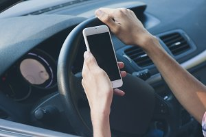 hands with mobile phone driving