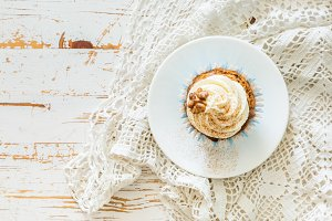 Carrot cake cupcakes with butter cream frosting