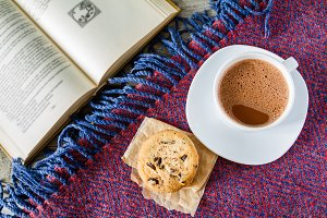 Autumn lifestyle - hot chocolate cookies, blanket book