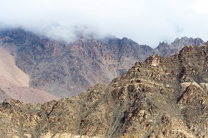 Rock mountains on foggy day landscape in Leh, India