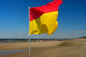 Flag on the Baltic beach