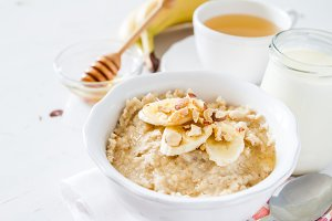 Autumn oatmeal in white bowl banana honey