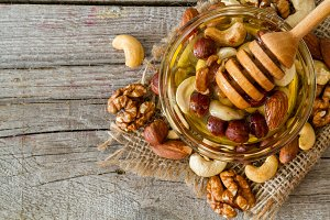 Honey and dipper selection of nuts