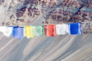 Colorful prayer flags with sun shining through one of prayer flags in Leh, Ladakh, India