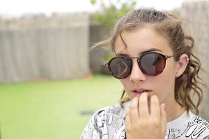 Teenager with sunglasses.