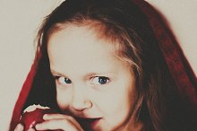 portrait of little girl with Apple
