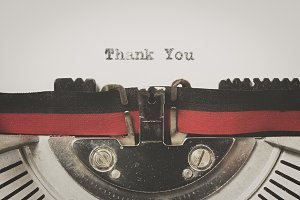 "Word ""thank you"" written on a vintage typewriter"