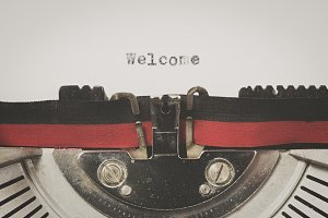 "Word ""welcome"" written on a vintage typewriter"
