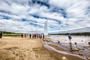 Icelandic geyser with tourists