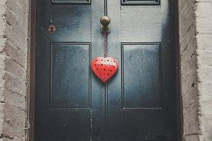 Red heart on door
