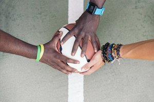 Multiethnic Friends Stacking Hands.