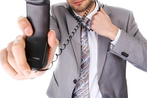 businessman with black telephone