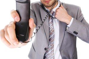 businessman with black telephone