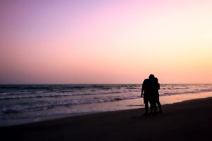 couples hugging on the beach