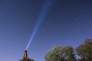 man looking at the stars