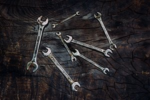 Set of spanners on a dark wooden