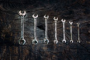 Spanners in order on a dark wooden