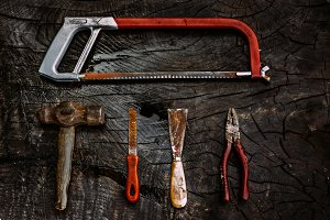 Set of manual tools on a dark wooden
