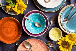 Colourful plates and bowls on table