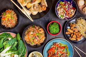 Chinese food on dark wooden table