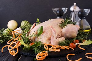 raw chicken with herbs spices ingredients, ready for cooking